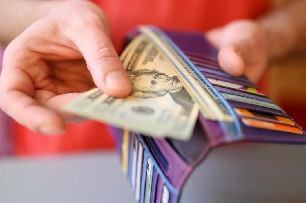 Dollar bills in wallet