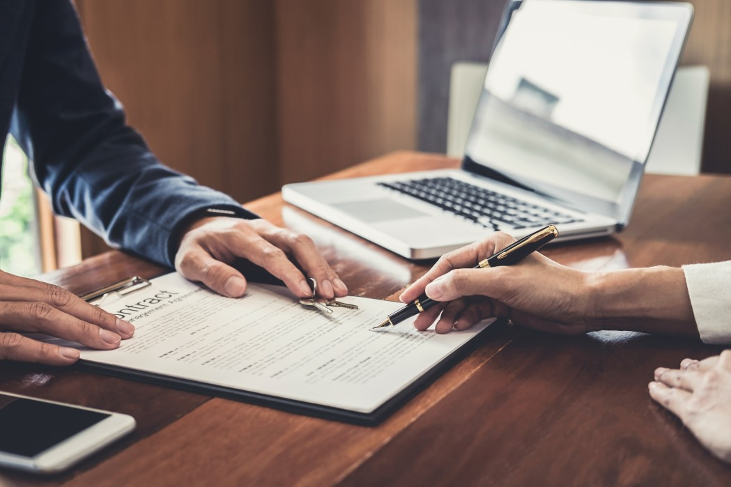 Signing a contract in an office